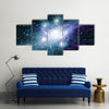 A Planet With Its Stars In Space Multi Panel Canvas Wall Art
