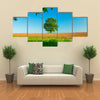 Tree in the field and blue sky Multi Panel Canvas Wall Art
