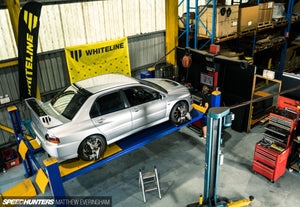 Speedhunters Matthew Everingham Evo 9 on alignment rack at Whiteline HQ