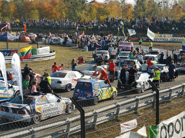 Crews and competitors parade the Torun RallyCross circuit in Poland