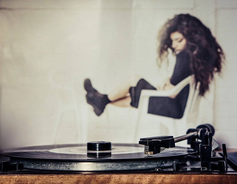 girl listening to a vinyl record