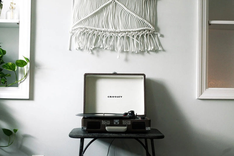 Crosley record player against white with macrame decor