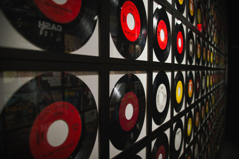 vinyl records framed on a wall