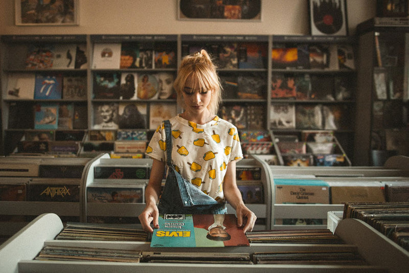 Young girl browsing vinyl record albums