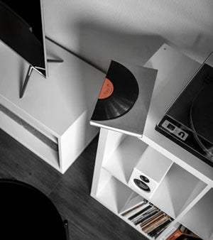 Minimalist bookcase with turntable and vinyl music collection