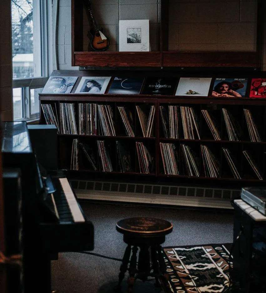 Vinyl records stored with industrial chic interior design