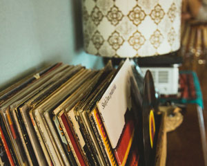 stack of records next to lamp
