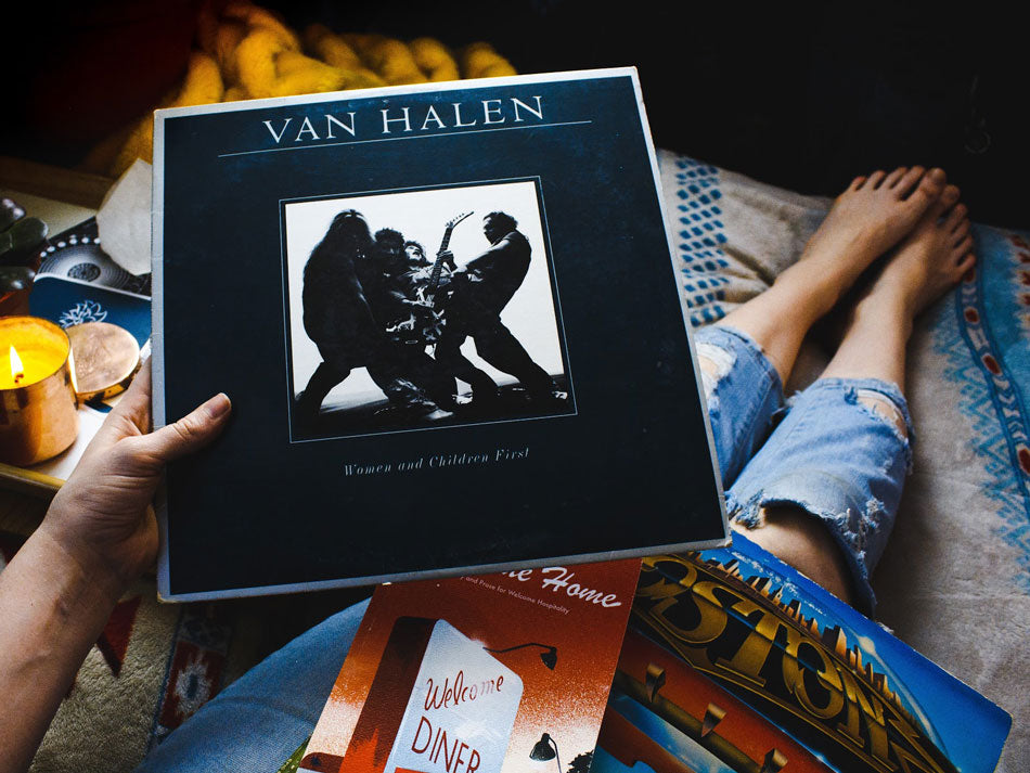 Record collector holding a Van Halen record wearing jeans