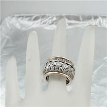 Sterling silver ring with 9k rose gold decorated with sparkling zircons.