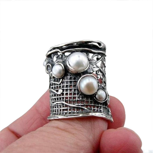 Sterling silver net texture wide ring with 5 natural white gemstones.