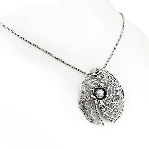 Round sterling silver net pendant with white natural gemstone.