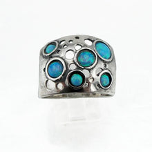 Sterling silver wide ring with blue opal dots.