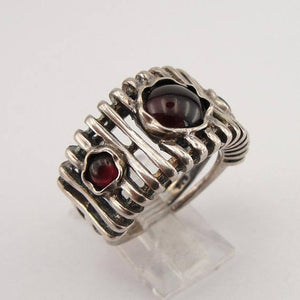 Wide lines' texture sterling silver ring with three round Natural Garnet gemstones.