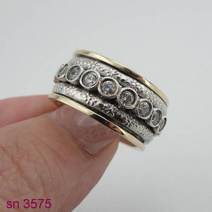 Two Silver Ring and in Center Studded Zircons Swivel Ring