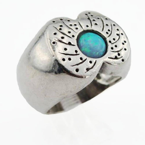 Wide and chunky sterling silver ring with a dot of mosaic Opal