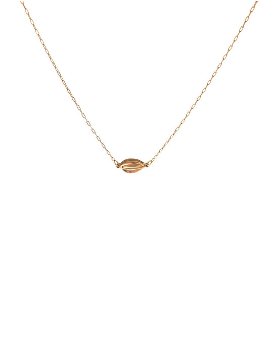 Tiny gold pod necklace