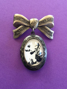 PETER PAN Brooch - locket pendant on bow pin - Silhouette Jewelry