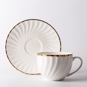 Elegant White Tea Cup and Saucer with Gold Detail - Staunton and Henry