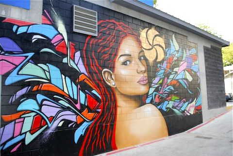 image of outdoor Austin murals featuring portrait and graffiti