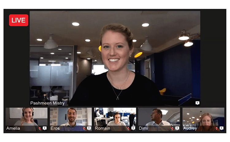 a woman in black shirt have a video conference  with other employees