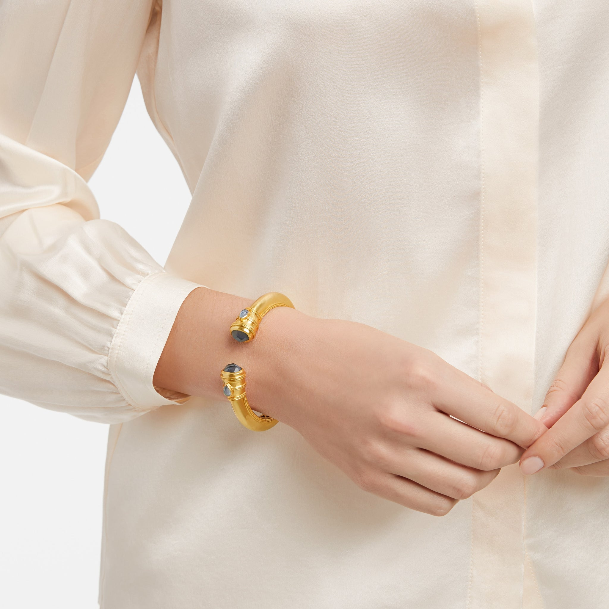 Cassis, a Julie Vos Hinge Cuff bracelet on the wrist of a woman, carousel, roll-over