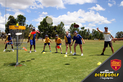 Juho Rantalaiho from Team Discmania teaching Disc Golf to school kids