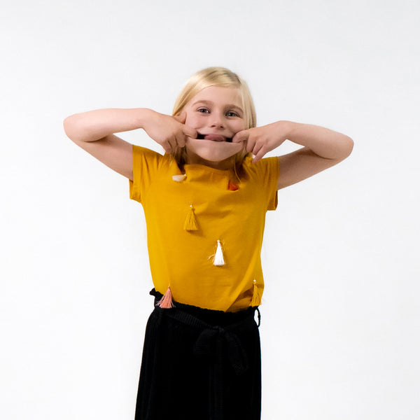Girls mustard yellow t-shirt tassels in pink white mustard easy to wear stylish cool trendy kids clothes