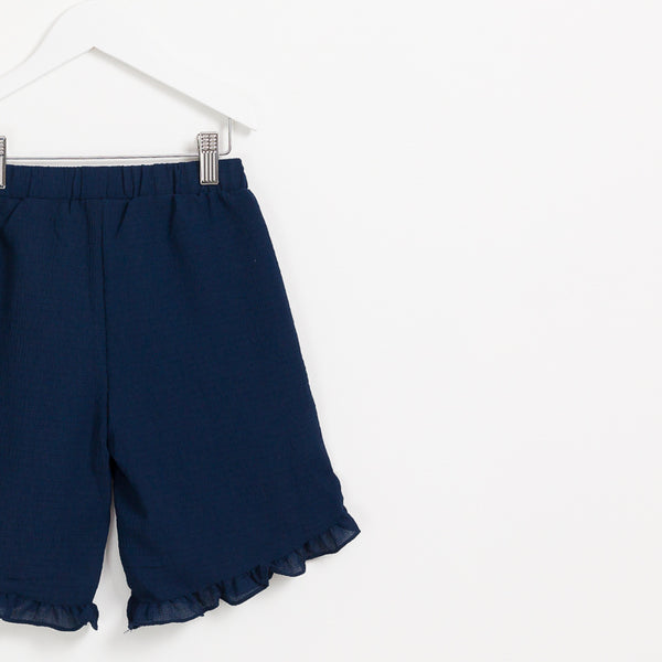 Girls kids navy cropped crepe summer trousers with frill hem