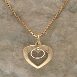 Shackled Heart Pendant - yellow and white gold