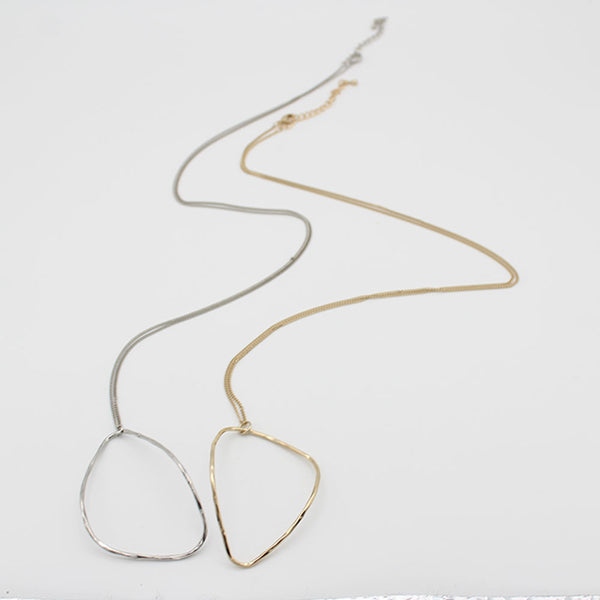 Silver and gold necklace on a white background