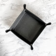 Black leather desk tray on a marble background