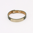 Khaki leather bracelet with gold detailing on a white background