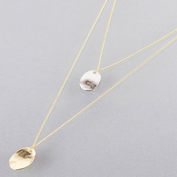 Gold necklace with a double chain and gold and silver detailing