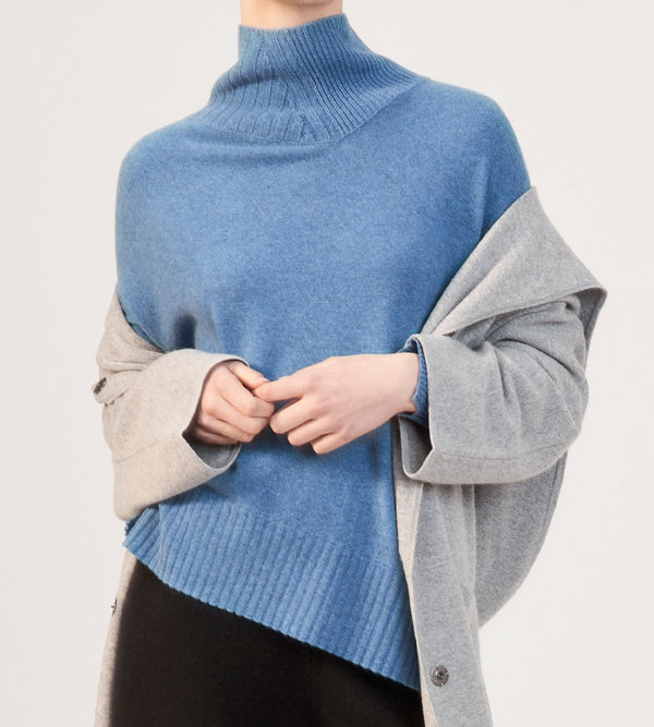 Relaxed Funnel Neck with Asymmetrical Hem