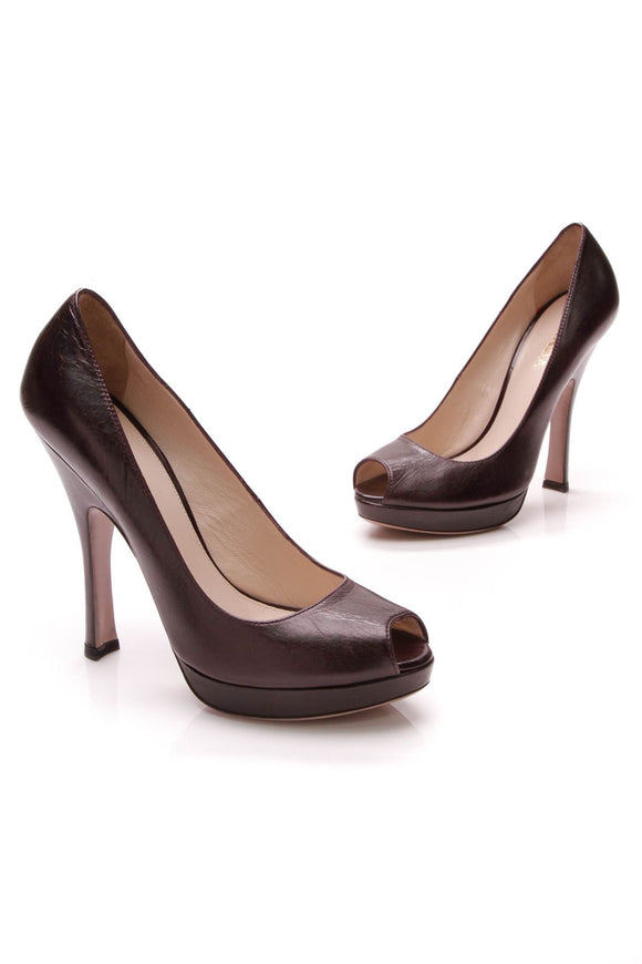 prada-vitello-shine-platform-pumps-mosto-purple