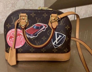 Louis Vuitton World Tour Alma bag