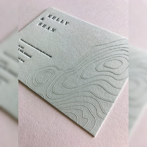 Blind embossed contour line on grey wedding invitation card for Kelly and Sean