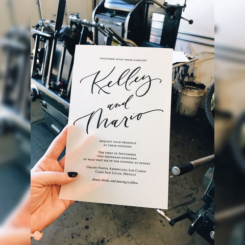 Kelly and Mario Request your presence at their wedding invitation card black flat print on white vellum