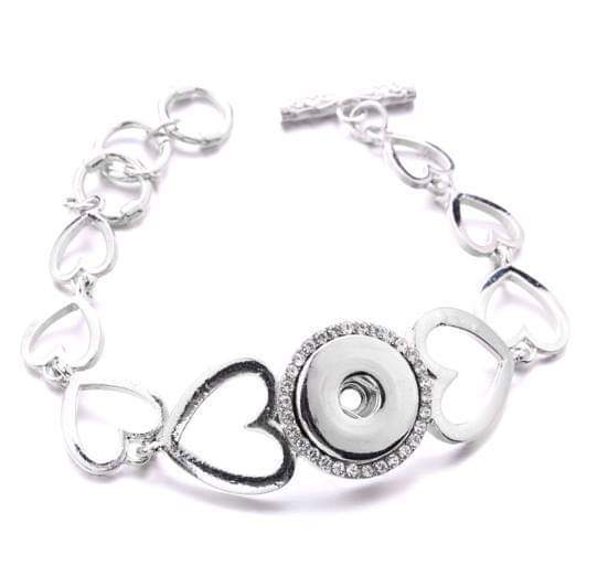 Silver Custom Heart Bracelet. Bracelet length is 8 inches. Image is circular .08 inches.