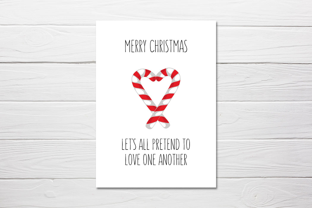 Merry Christmas let's all pretend to love on another Card