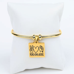 ME™ Peace Love Justice Goldtone Bangle Accessories Show Your Africa