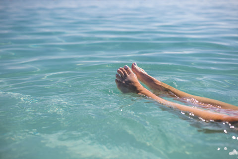 Feet floating in blue water - Photo by Matthew Henry from Burst