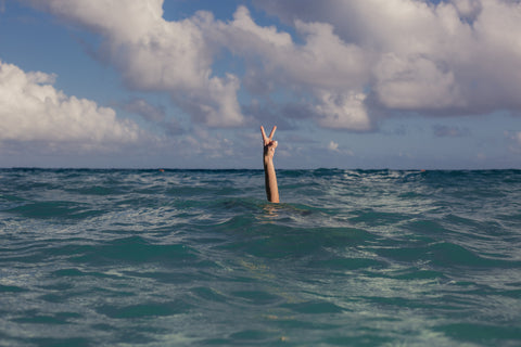 Vacation peace sign in the ocean - Photo by Matthew Henry from Burst