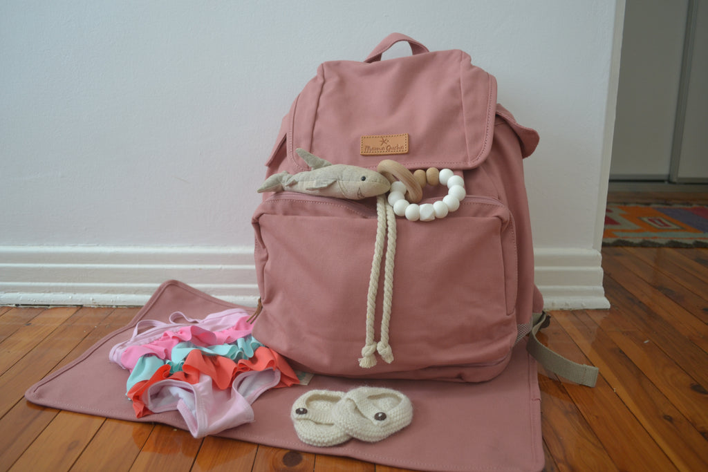 The Mama Qucha baby beach bag / diaper bag in pink, baby change mat and props
