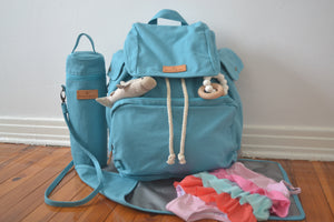 The Mama Qucha Baby Bundle | baby beach bag / diaper bag in turquoise, baby bottle carrier, baby change mat and props