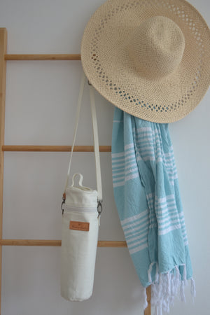 The Mama Qucha insulated bottle carrier / baby bottle holder in waxed white cotton show hanging