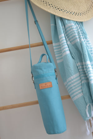 The Mama Qucha insulated bottle carrier / baby bottle holder in turquoise cotton show hanging