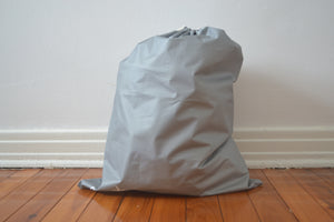 The Mama Qucha large drawstring wet bag when full