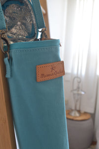 The Mama Qucha insulated bottle carrier / baby bottle holder in turquoise cotton show open