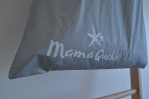 Close up of the Mama Qucha logo on the large drawstring wet bag